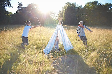 Small group of young boys playing around teepee Stock Photo - Premium Royalty-Free, Code: 649-07760869