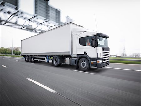 Freight truck on the move on motorway Stock Photo - Premium Royalty-Free, Code: 649-07760876