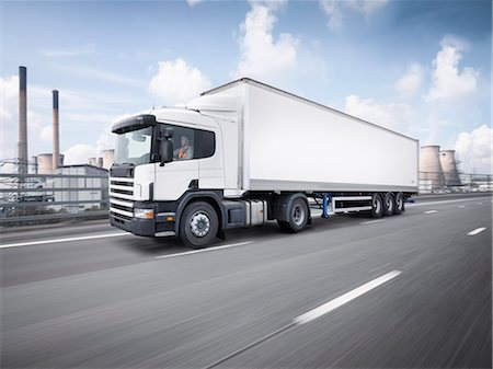 Freight truck on the move on motorway Stock Photo - Premium Royalty-Free, Code: 649-07760877