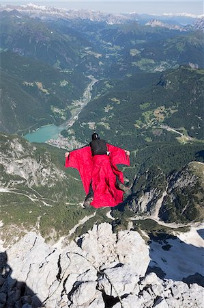 places - Mature man BASE jumping from mountain, Alleghe, Dolomites, Italy Stock Photo - Premium Royalty-Free, Code: 649-07760929
