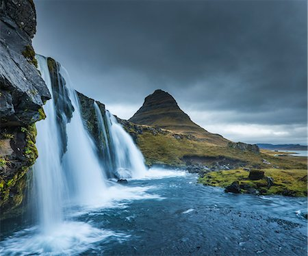 dreamy - Kirkjufellsfoss waterfall, Mt. Kikjufell in background, Snaefellsnes, Iceland Stock Photo - Premium Royalty-Free, Code: 649-07760943