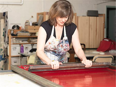 Woman hand-printing textile in workshop Stock Photo - Premium Royalty-Free, Code: 649-07760970
