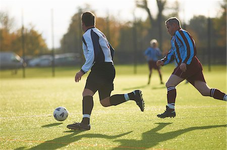 soccer player (male) - Football players during game Stock Photo - Premium Royalty-Free, Code: 649-07760984