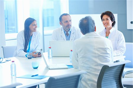 Group of researchers having meeting Stock Photo - Premium Royalty-Free, Code: 649-07761011