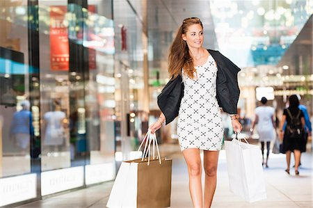 shopping mall - Mid adult woman walking with shopping bags Stock Photo - Premium Royalty-Free, Code: 649-07761051