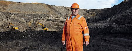 portrait looking away - Portrait of mature quarry worker in quarry site Stock Photo - Premium Royalty-Free, Code: 649-07804084