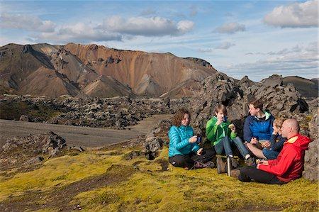 sitting - Family having lunch at Landmannalaugar, Fjallabak, Iceland Stock Photo - Premium Royalty-Free, Code: 649-07804130