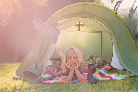 Portrait of girl lying gazing from garden tent Stock Photo - Premium Royalty-Free, Code: 649-07804173