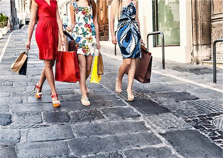 self indulgence - Neck down view of three fashionable young women shoppers, Cagliari, Sardinia, Italy Stock Photo - Premium Royalty-Free, Code: 649-07804272