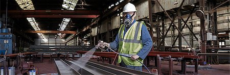 Portrait of a steelworker in his working environment Stock Photo - Premium Royalty-Free, Code: 649-07804373