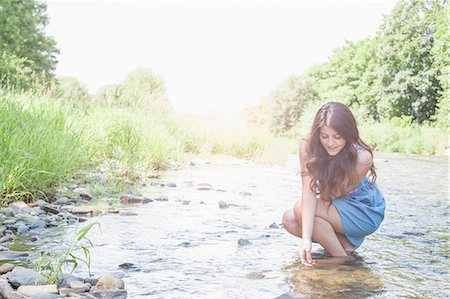Young woman in shallow stream Stock Photo - Premium Royalty-Free, Code: 649-07804536