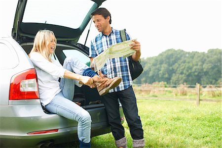 female rear end - Couple at rear of car map reading preparing for walk Stock Photo - Premium Royalty-Free, Code: 649-07804579