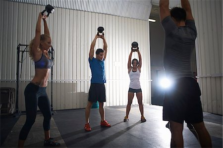 Crossfitters working out with kettlebell in group class Stock Photo - Premium Royalty-Free, Code: 649-07804606