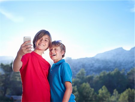 Two brothers taking selfie on smartphone, Majorca, Spain Stock Photo - Premium Royalty-Free, Code: 649-07804668