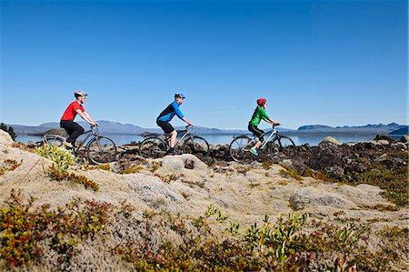 Cyclists cycling in Thingvellir national park with Thingvallavatn and Langjokull in the background, Nesjavellir, Iceland Stock Photo - Premium Royalty-Free, Code: 649-07805157