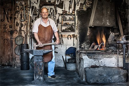 rustic - Portrait of senior male blacksmith in traditional workshop, Cagliari, Sardinia, Italy Stock Photo - Premium Royalty-Free, Code: 649-07803227