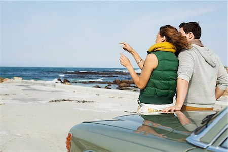 sweater - Rear view of young couple leaning against car at coast, Cape Town, Western Cape, South Africa Stock Photo - Premium Royalty-Free, Code: 649-07803271