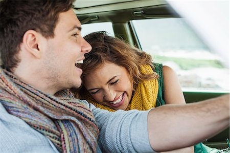 Young couple driving car laughing, Cape Town, Western Cape, South Africa Stock Photo - Premium Royalty-Free, Code: 649-07803272