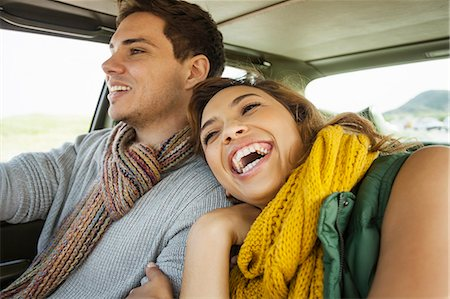 Young couple laughing whilst driving, Cape Town, Western Cape, South Africa Stock Photo - Premium Royalty-Free, Code: 649-07803273