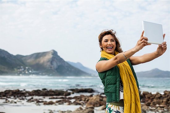Young woman taking selfie with digital tablet on beach, Cape Town, Western Cape, South Africa Stock Photo - Premium Royalty-Free, Image code: 649-07803283