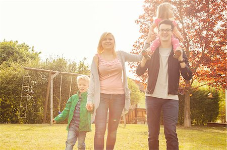 family fun day background - Family in garden, swings in background Stock Photo - Premium Royalty-Free, Code: 649-07803505