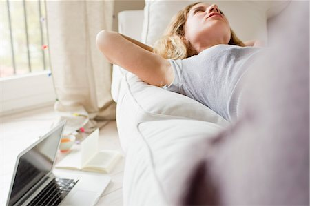 Woman lying on sofa day-dreaming Stock Photo - Premium Royalty-Free, Code: 649-07803516