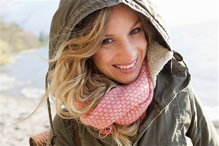 Woman all wrapped up on windy beach Stock Photo - Premium Royalty-Free, Code: 649-07803526