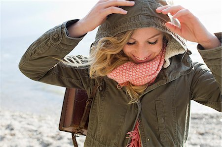 fall - Woman all wrapped up on windy beach Stock Photo - Premium Royalty-Free, Code: 649-07803527