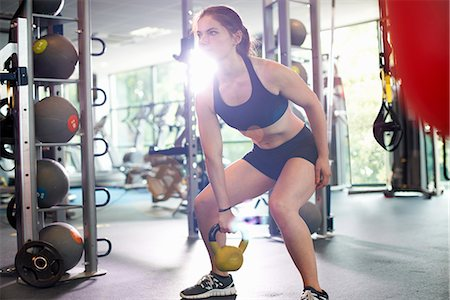 Young woman lifting kettlebell Stock Photo - Premium Royalty-Free, Code: 649-07803805