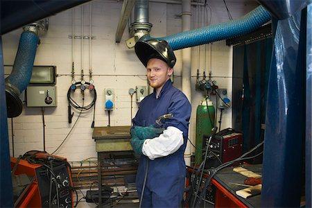 Portrait of male student welder in college workshop Stock Photo - Premium Royalty-Free, Code: 649-07803911