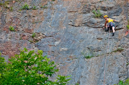 """rock climber - Female climber, leading """"The Tory"""" at Fairy Cave Quarry Stock Photo - Premium Royalty-Free, Code: 649-07803941"""