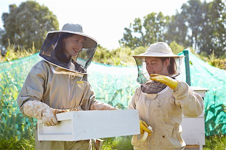 Two female beekeepers chatting on city allotment Stock Photo - Premium Royalty-Free, Code: 649-07803954