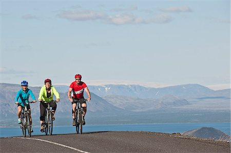 fun happy colorful background images - Cyclists on road next to Thingvallavatn, Langjokull in  background, Thingvellir National Park, South West Iceland Stock Photo - Premium Royalty-Free, Code: 649-07904996