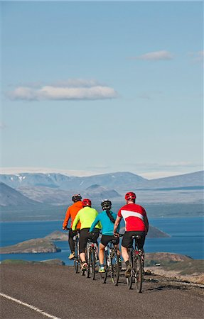 Cyclists on road next to Thingvallavatn, Langjokull in  background, Thingvellir National Park, South West Iceland Stock Photo - Premium Royalty-Free, Code: 649-07904997