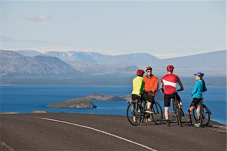 Cyclists taking break on road next to Thingvallavatn, Langjokull in background, Thingvellir National Park, South West Iceland Stock Photo - Premium Royalty-Free, Code: 649-07904998