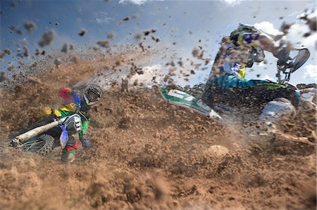 fit people - Two young male motocross riders racing through mud Stock Photo - Premium Royalty-Free, Code: 649-07905002