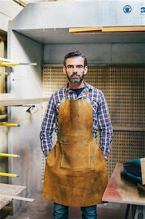 Portrait of mature craftsman in organ workshop Stock Photo - Premium Royalty-Free, Code: 649-07905050