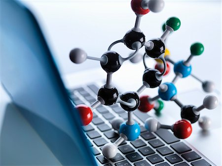 Molecular model sitting on top of lap top computer keyboard to illustrate science education and computer aided research Stock Photo - Premium Royalty-Free, Code: 649-07905104