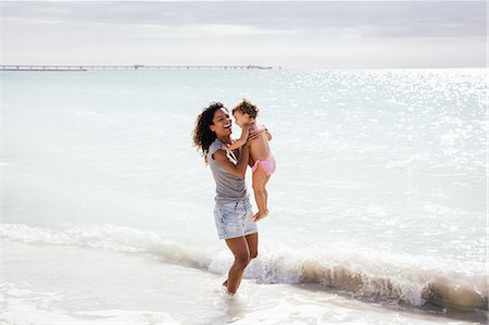 Mother and toddler daughter paddling in sea, Tuscany, Italy Stock Photo - Premium Royalty-Free, Code: 649-07905249