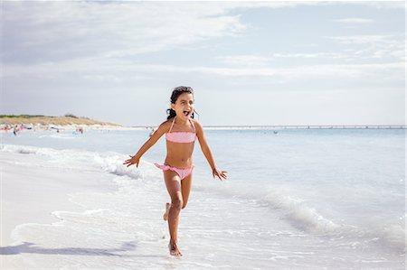 Girl running on beach, Tuscany, Italy Stock Photo - Premium Royalty-Free, Code: 649-07905253
