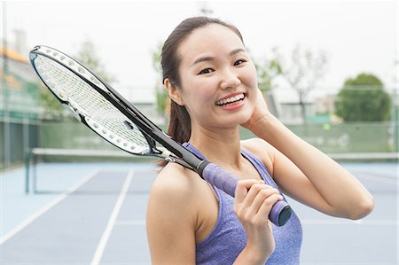Portrait of young female tennis player on tennis court Stock Photo - Premium Royalty-Free, Code: 649-07905289