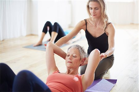 fitness   mature woman - Pilates teacher holding student arms in class Stock Photo - Premium Royalty-Free, Code: 649-07905342