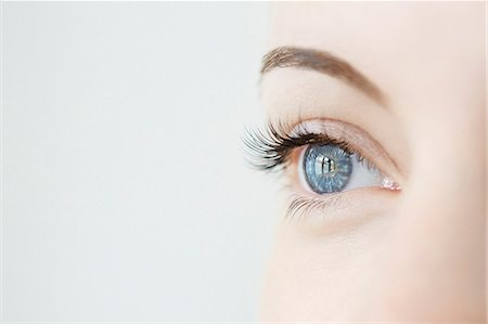 Studio close up of mid adult womans gazing blue eye Stock Photo - Premium Royalty-Free, Code: 649-07905374