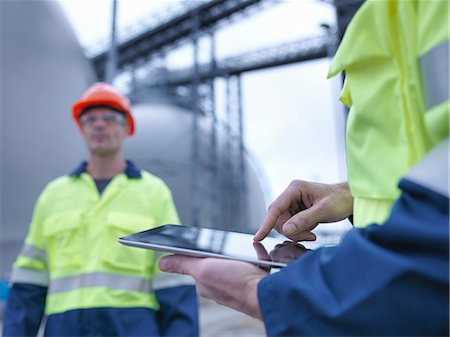 power - Workers using digital tablet at biomass facility, close up Stock Photo - Premium Royalty-Free, Code: 649-07905378