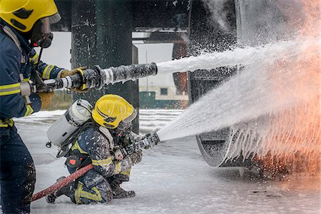 fire - Firemen spraying water on simulated aircraft fire at training facility Stock Photo - Premium Royalty-Free, Code: 649-07905592