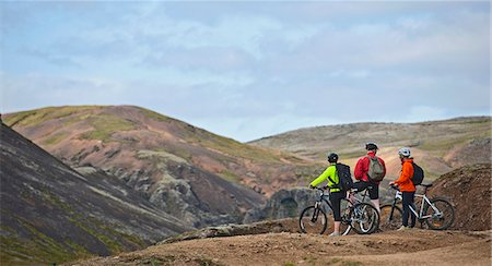 people and vacation - Three mountain bikers taking a break at viewpoint,  Reykjadalur valley, South West Iceland Stock Photo - Premium Royalty-Free, Code: 649-07905693