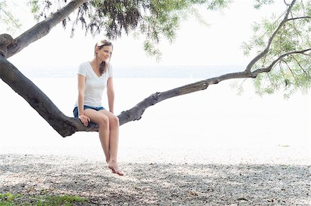 Woman relaxing on beach, Ammersee, Herrsching, Bavaria, Munich Stock Photo - Premium Royalty-Free, Code: 649-07905722