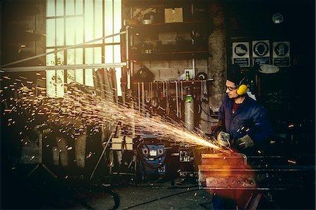 Welder cutting iron in workshop Stock Photo - Premium Royalty-Free, Code: 649-08004000