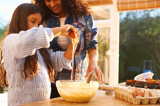 Mother and daughter baking in kitchen Stock Photo - Premium Royalty-Free, Image code: 649-08004026