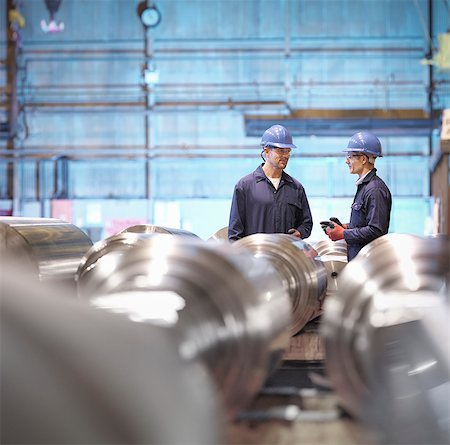 Engineers in discussion in engineering factory Stock Photo - Premium Royalty-Free, Code: 649-08004214